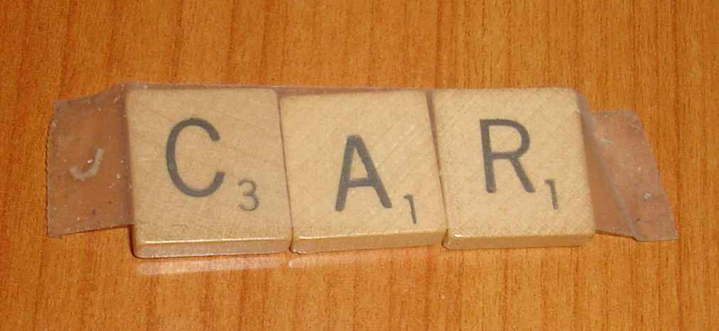 Scrabble tiles spelling the word CAR