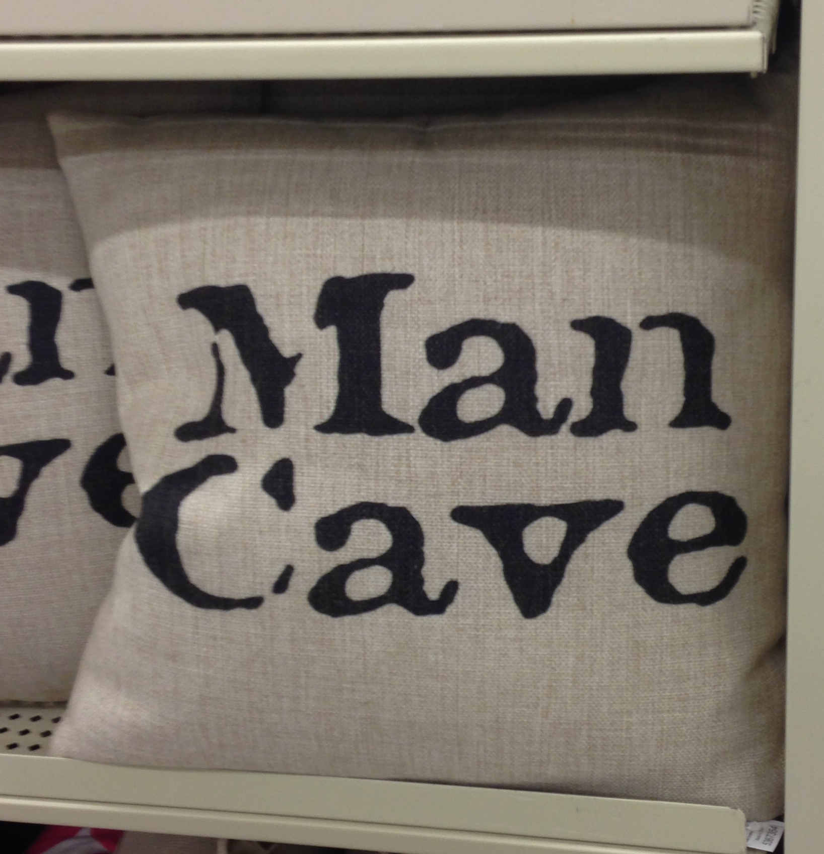 The Man Cave Throw Pillow paradox