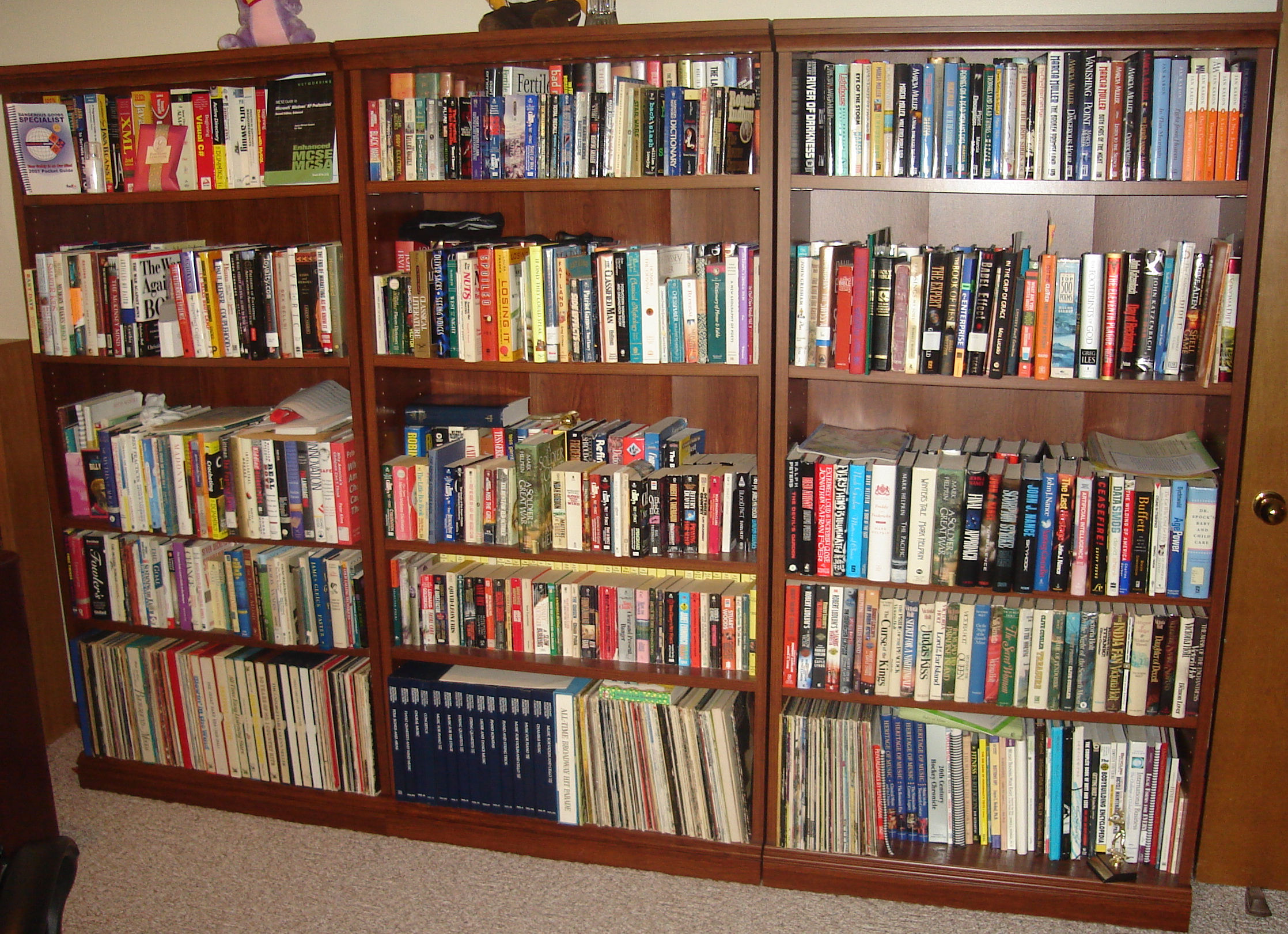 Three bookshelves in Heather's office