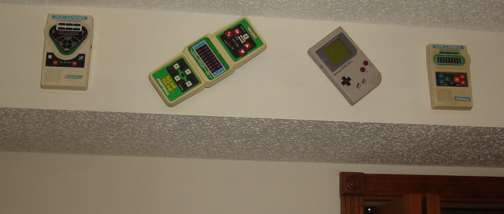 Old handheld games mounted on the wall